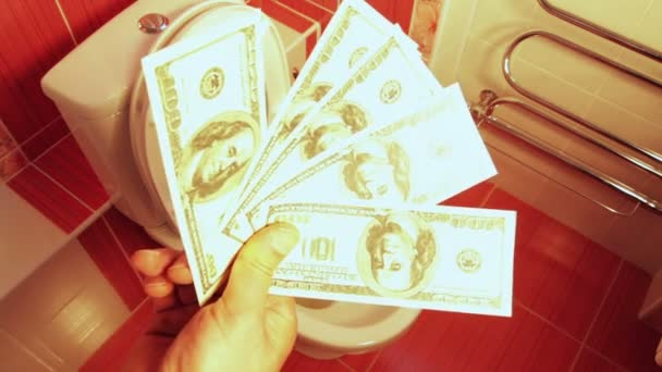 peníze dolarů hozený do záchodu