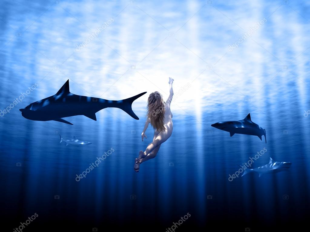 Sharks and woman swimming in rays with sun