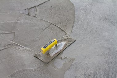 Trowel on fresh concrete