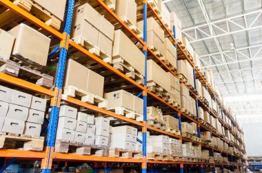 Rows of shelves with boxes in modern warehouse stock vector