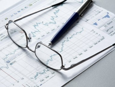 Pen, business chart and glasses
