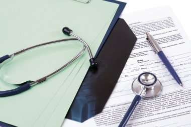 A stethoscope on a medical billing