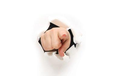 Hand breaking through paper