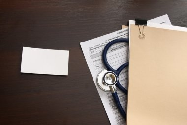 A blank, a medical record form with a stethoscope