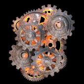 Fotografia ingranaggi meccanici di metallo arrugginito con una luce rossa posteriore