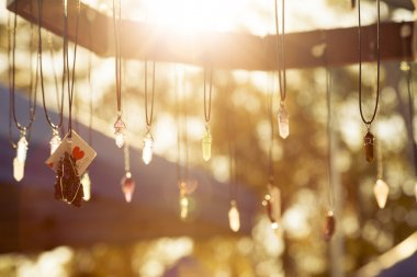 Handmade necklaces hanging in the sunlight