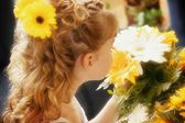 Flower Girl Smelling Bouquet