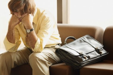 Man Dozing In Airport