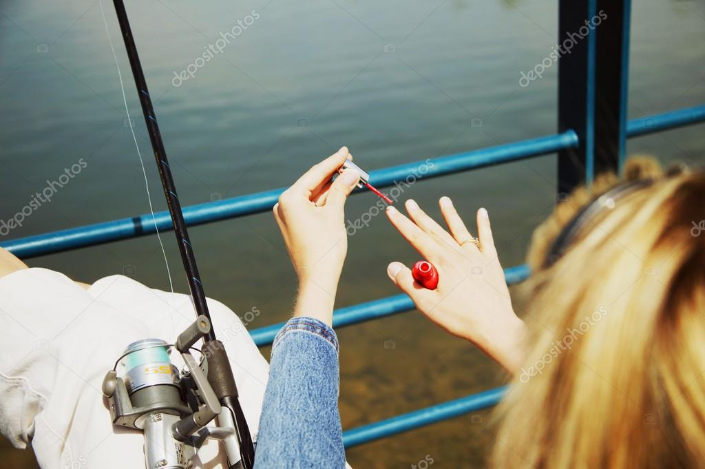 Woman Painting Her Nails During Fishing