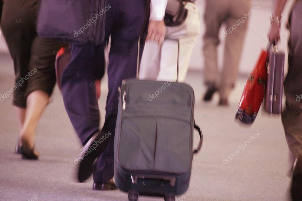 People With Suitcases In A Hurry