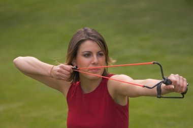 Woman With Slingshot