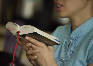 Woman Reading From The Bible
