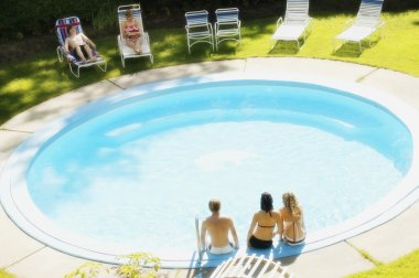 Teens Sitting At A Pool