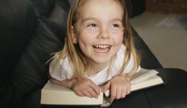 A Young Girl Enjoying Her Book