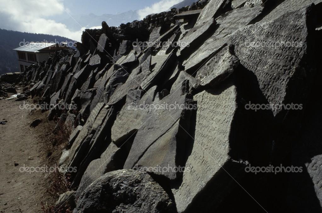 Broken Carved Stones Alongside Path