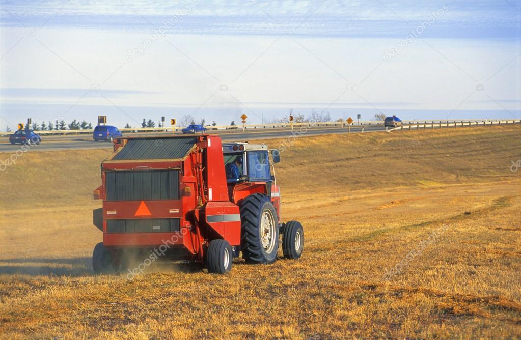 Tractor Working Beside Highway