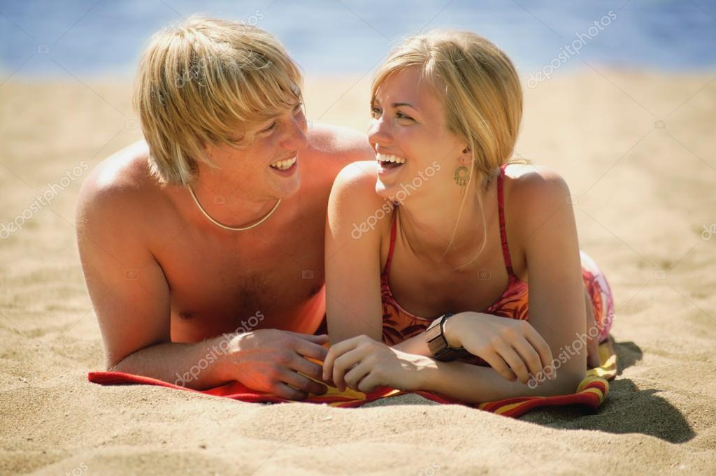 A Young Couple On The Beach