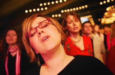Woman Worshipping The Lord