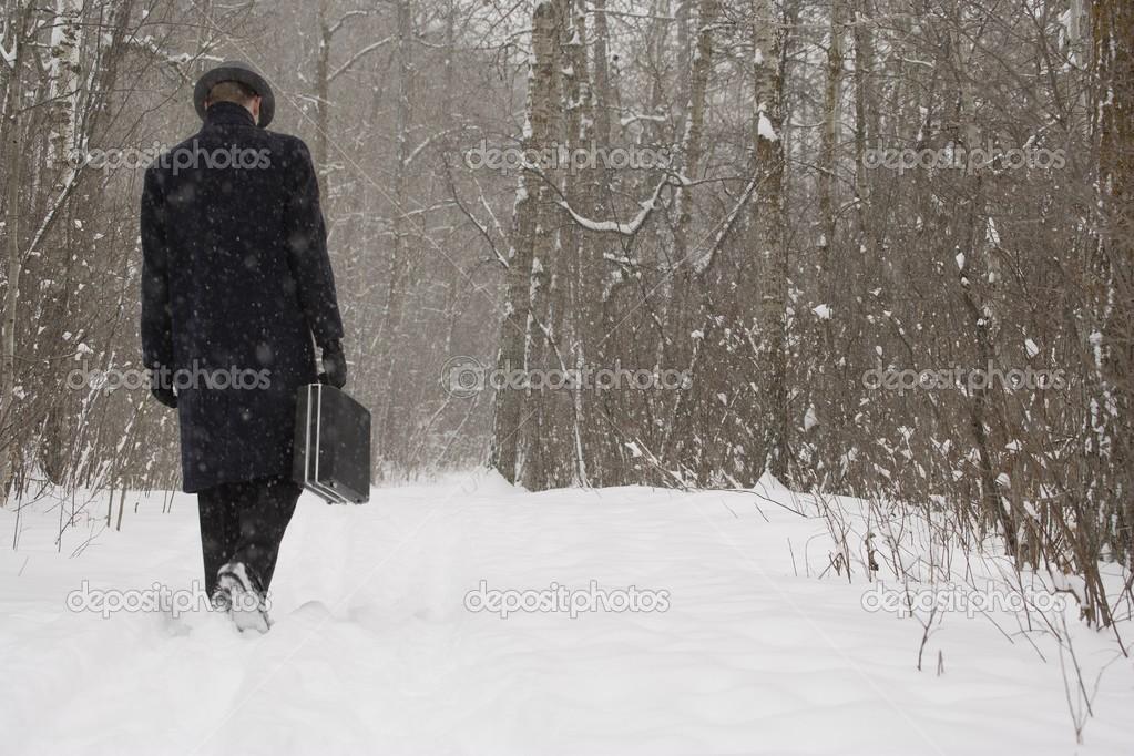 Businessman Walking Through The Snow