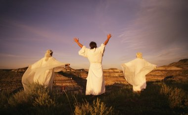 Three Angelic People On Top Of Mountains