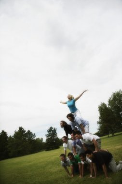 A Group Of Young People Making A Pyramid