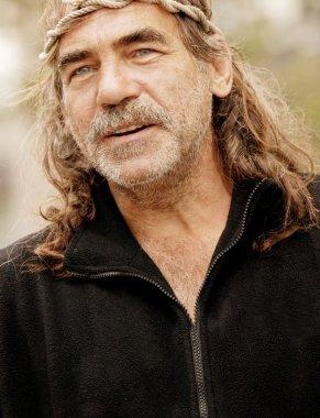 Senior Man With Long Hair And Headband