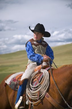 Young Cowboy On Horse
