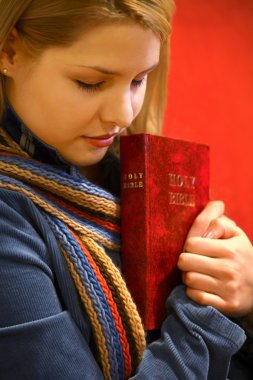 Teen Holds Bible And Prays