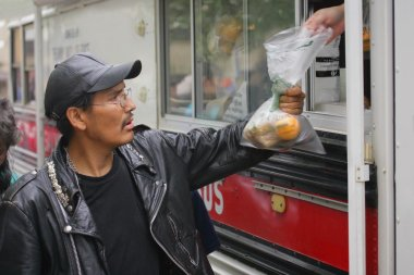 Food Being Given To A Man