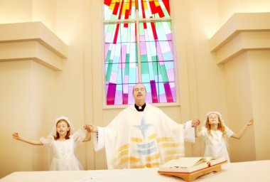 Priest With Girls On First Communion