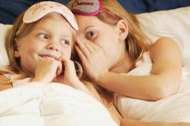 Girls Whispering In Bed