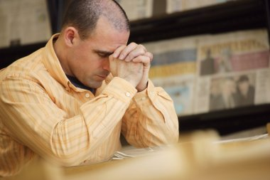 Man Praying In Library
