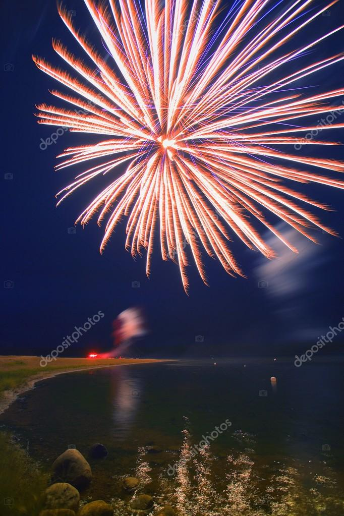 Fireworks Over A Body Of Water