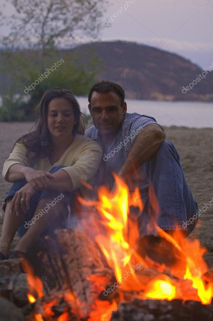 Couple Sitting By Fire