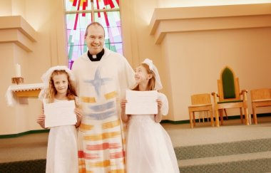 Priest With Two Children