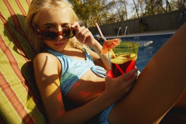 Child Relaxes Beside Pool