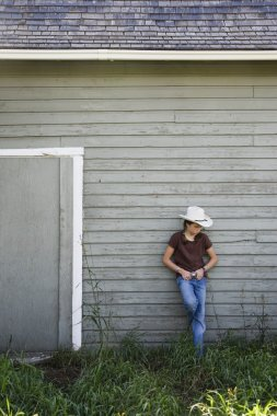 Young Cowgirl On Farm