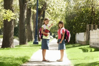 Two Girls Walking To Or From School