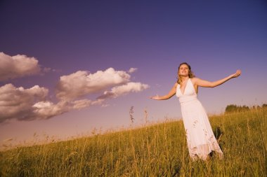 Woman Worshiping In A Field