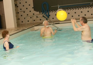 Seniors Playing Ball In A Pool