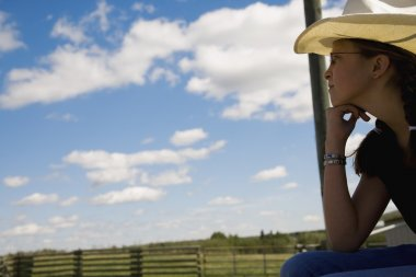 Girl On Farm Wearing Cowboy Hat