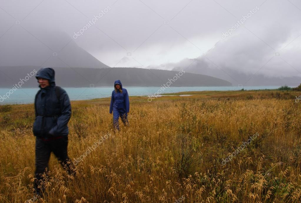 Friends Hiking In The Rain