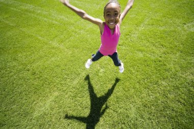 Young Girl Doing Jumping Jacks
