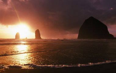 Sunset On Haystack Rock At Cannon Beach