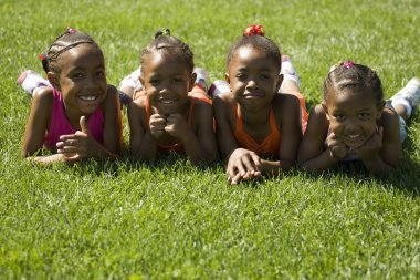 Four Girls Laying On The Grass