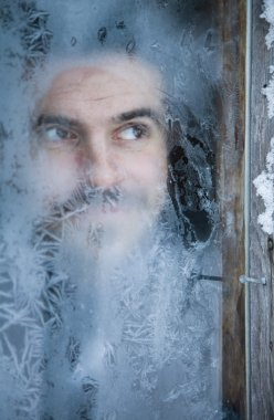 Man Looking Through Frosted Glass