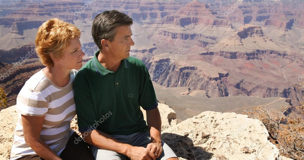 Couple Looking Out At Over Canyon