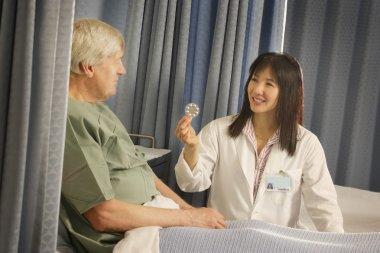 Doctor Prescribes Pills To Patient
