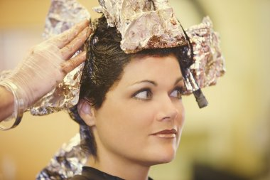 Woman Having Her Hair Dyed