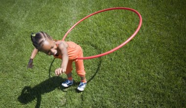 Child Plays With Hoop